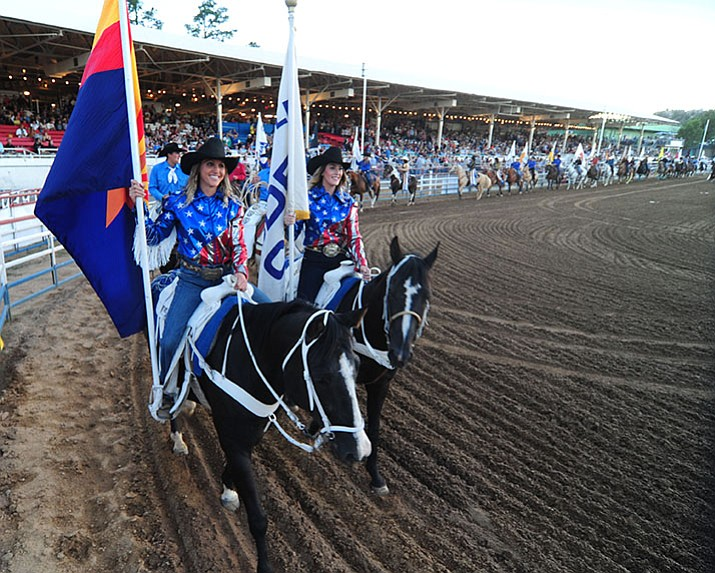 The grand entry makes its way around the arena during the opening performance of the Prescott Frontier Days Rodeo this year at the Prescott Rodeo Grounds. It's one of the region's top tourism draws. (Les Stukenberg/Courier)