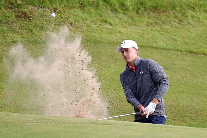 Jordan Spieth plays out of a bunker on the 17th hole during Saturday's third round of the British Open. (Peter Morrison/AP)