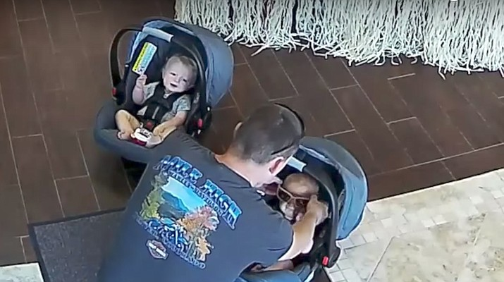 Police say the suspect came into a Philadelphia vision store Wednesday carrying two babies in car seats. Video footage from the store shows him using the babies to help him steal about $1,000 worth of sunglasses.