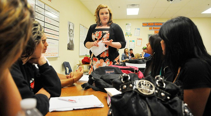 Bradshaw Mountain High School English teacher Amanda Hiler talks with students. The school districts are combining efforts to better manage substitute teachers when the need arises. (Les Stukenberg/Courier file)