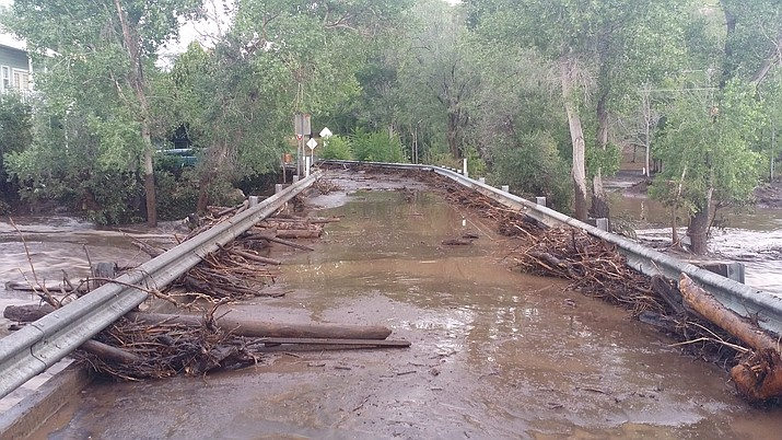 Flooding from monsoon rains has caused damage to roads near Mayer. (Chris Porter/courtesy)