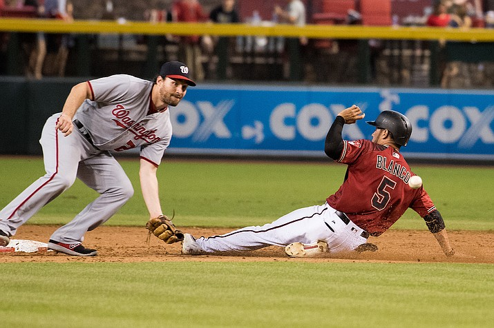 Gregor Blanco slides into second ahead of the ball with Washington Nationals' Daniel Murphy waiting July 23.
