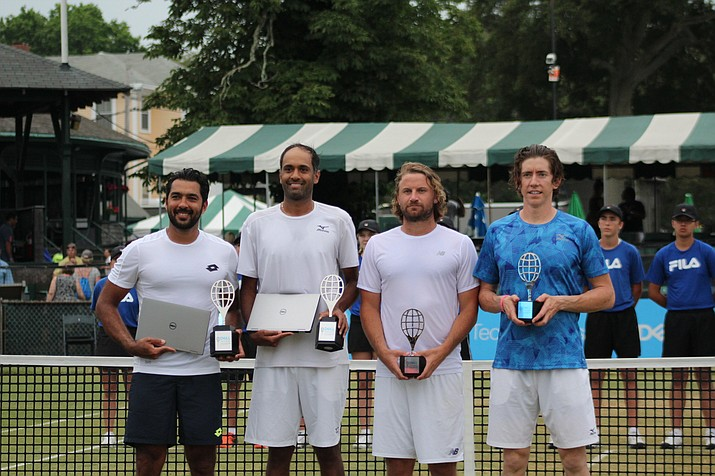 From left to right: Winners Rajeev Ram, Pak Qureshi stand with finalists Matt Reid and John-Patrick Smith at the International Tennis Hall of Fame Open on July 23 in Newport, Rhode Island. (Adriana Armesto-Howard/Courtesy)