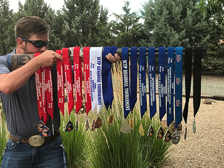Colton Underwood with the medals he's won for sport shooting. (Kristen Underwood/Courtesy)