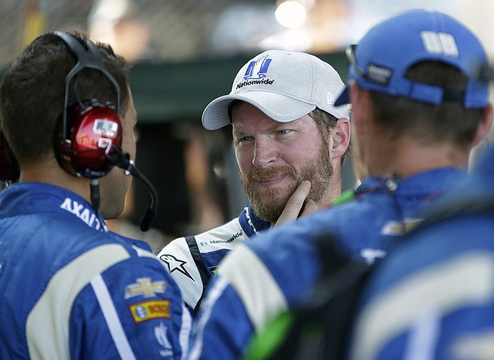 Dale Earnhardt Jr. (88) talks with his crew after dropping out of the NASCAR Brickyard 400 auto race at Indianapolis Motor Speedway in Indianapolis on Sunday, July 23, 2017. (AJ Mast/AP)