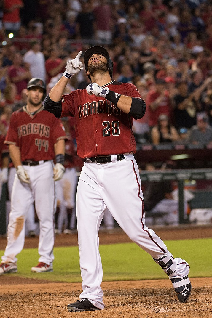 Arizona Diamondbacks outfielder J.D. Martinez crosses home plate after one of his two home runs in a 10-3 win over the Braves Wednesday at Chase Field.