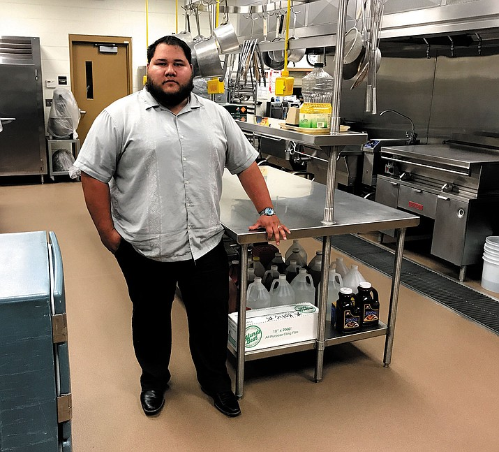 KUSD Food Services Director Alex Mayo stands in the district's central kitchen, which starting Wednesday, will be cranking out meals for thousands of students.