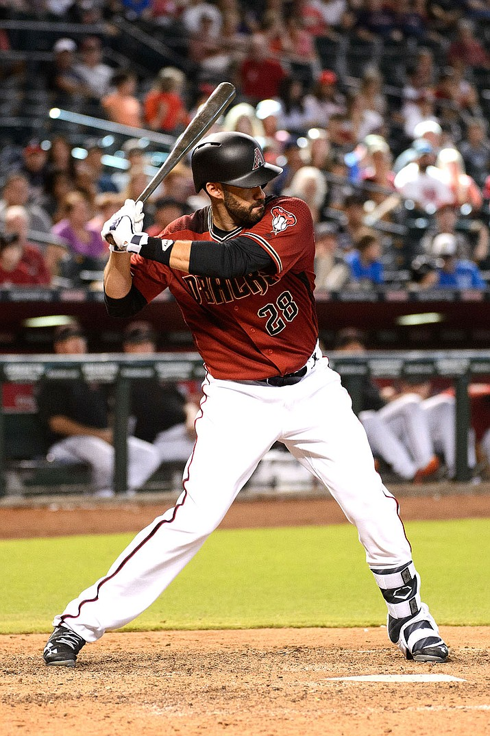 J.D. Martinez hit a grand slam Thursday to lead the Diamondbacks past the Cardinals, 4-0.