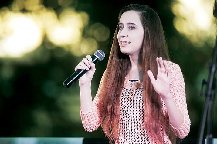 "Hannah Warren sings ""Someone Like You"" during the first round of Prescott Idol 2017 Thursday, June 1, on the Yavapai County Courthouse Plaza. The Idol competition continues Thursday, Aug. 3. (Les Stukenberg/Courier)"