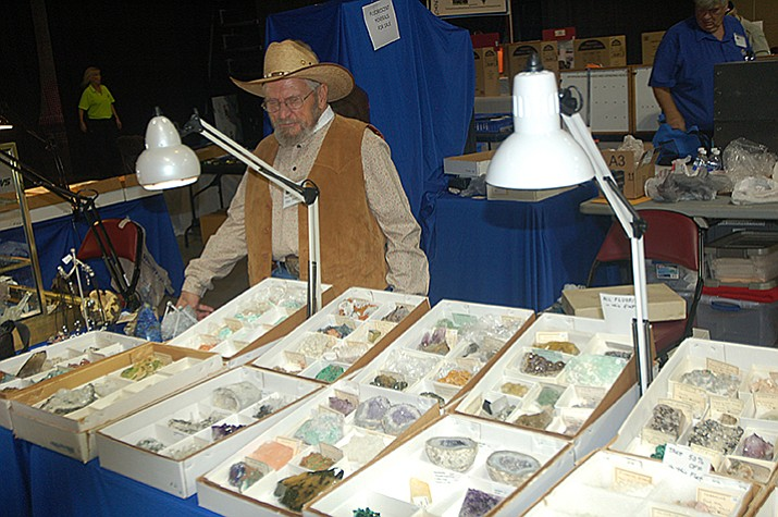Ken Foster shows off rocks and gems at the 2014 Prescott Gem & Mineral Club Show & Sale. This year's show is the 14th annual show for the club and will be Friday through Saturday, Aug. 4-6, at the Prescott Valley Event Center. (Jason Wheeler/Courier)