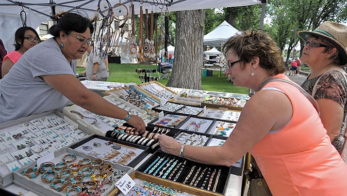 Lita Thompson, left, of Kaibeto, Arizona, shows P.Jai Smith a Navajo made copper bracelet while Patsy McCullough looks on during a previous Williamson Valley Fire District Arts & Crafts Show in downtown Prescott. (Courier file photo)