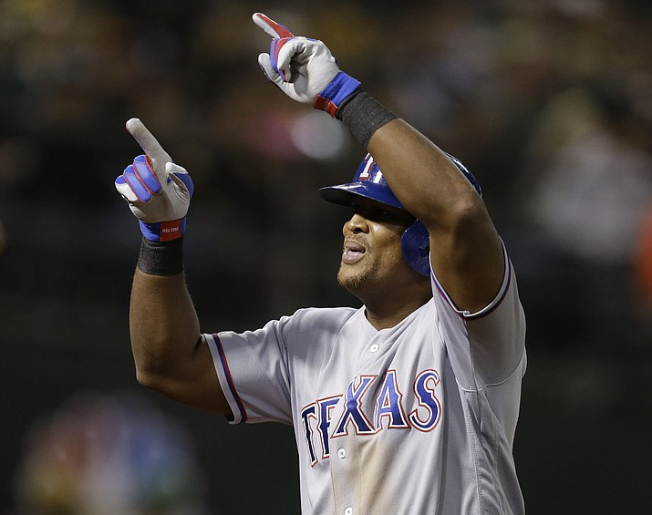 In this Sept. 23, 2016, file photo, Texas Rangers' Adrian Beltre celebrates after hitting a two-run home run against the Oakland Athletics in the seventh inning of a baseball game, in Oakland, Calif. The five-time Gold Glove third baseman for the Rangers, now in his 20th MLB season, is on the verge of becoming only the 31st player with 3,000 career hits. (Ben Margot/AP, File)