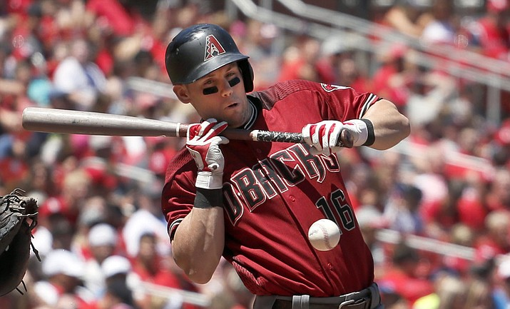 Arizona Diamondbacks' Chris Owings reacts after being hit while trying to bunt during the second inning of a baseball game, Sunday, July 30, 2017, in St. Louis. Owings left the game due to injury after the play. (Jeff Roberson/AP)