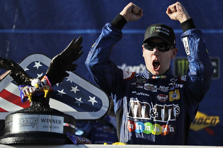 Kyle Busch celebrates after winning the NASCAR Cup Series auto race at Pocono Raceway, Sunday, July 30, in Long Pond, Pa. (Matt Slocum/AP)