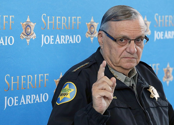 In this Dec. 18, 2013 file photo, Maricopa County Sheriff Joe Arpaio pauses as he answers a question at a news conference at Maricopa County Sheriff's Office Headquarters in Phoenix. Arpaio was convicted of a criminal charge Monday, July 31, 2017, for refusing to stop traffic patrols that targeted immigrants. (Ross D. Franklin/AP, File)