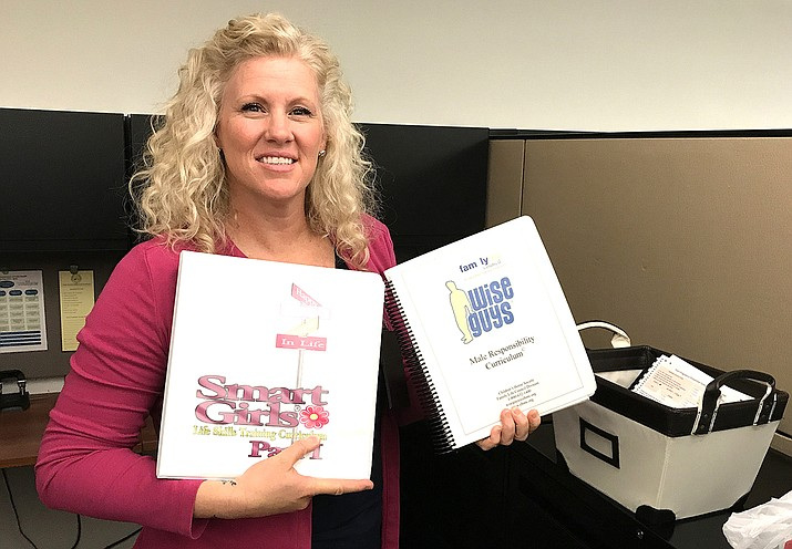 Mohave County Department of Public Health Specialist Tiffany Mathews with the Smart Girls and Wise Guys curriculum.