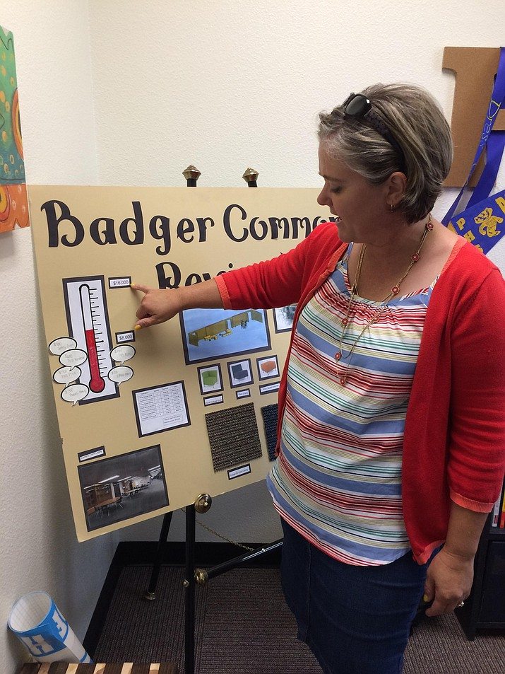 PHS Assistant Principal Amy Buettner reviews the plans and charts for the new Badger Commons.