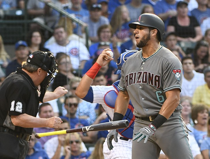 Arizona Diamondbacks David Peralta (6) flips his bat after being called out on strikes during the first inning against the Chicago Cubs on Tuesday, Aug. 1, 2017, in Chicago. (Matt Marton/AP)
