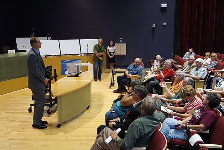 Locals gather to listen during informational meeting. (Cindy Barks/Courier)