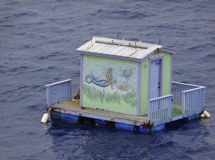 A tiny house with a mermaid on the side floats adrift in the Gulf of Mexico south of Grand Isle, La. The Coast Guard asks the public for any information regarding the dock. (Petty Officer 3rd Class Travis Magee/U.S. Coast Guard via AP)
