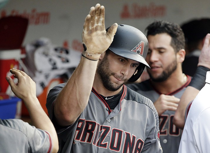 Arizona Diamondbacks' Paul Goldschmidt celebrates with teammates after hitting a solo home run against the Chicago Cubs during the ninth inning Thursday, Aug. 3, 2017, in Chicago. (Nam Y. Huh/AP)