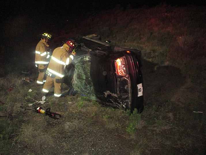 Fire crews work to right a SUV after a rollover at the Highway 89A on-ramp at Glassford Hill Road on Wednesday. (Prescott Valley Police/Courtesy)