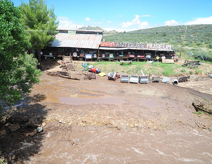 Smitty's Antiques Museum gets a scare as Big Bug Creek washes over it's banks forcing evacuations in Mayer Friday, Aug 4. (Les Stukenberg/Courier)