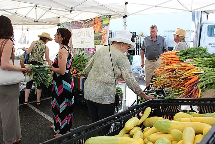 Customers peruse the selection of produce offered by Whipstone Farm at the Prescott Farmers Market on Saturday, Aug. 29. (Max Efrein/Courier)