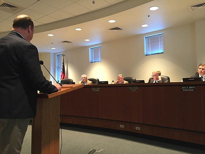 Yavapai County Administrator Phil Bourdon addresses the Yavapai County Board of Supervisors about its decision to approve the 2017-18 fiscal budget. (Max Efrein/Courier)