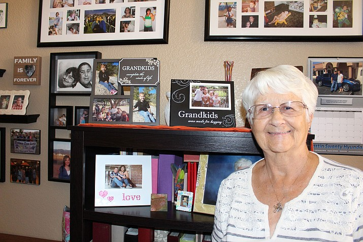 Mary Bathauer shows some of the grandkids' pictures in her home.