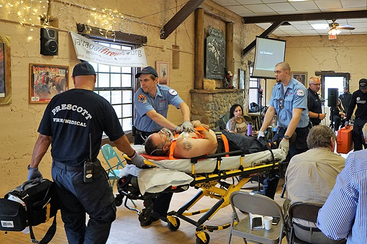 Prescott Fire and Lifeline Ambulance staffers conduct a drill on Aug. 3 to show members of the Prescott Area Wildland Urban Interface Commission the time and staff needed to deal with one of the community's most common calls – a possible heart attack. (Cindy Barks/Courier)
