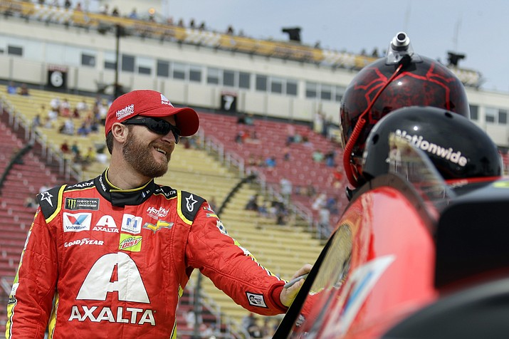 Dale Earnhardt Jr. smiles while talking with a crew member before qualifying for the NASCAR Cup Series auto race, Sunday, Aug. 6, in Watkins Glen, N.Y. (Matt Slocum/AP)