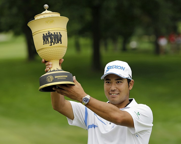 Hideki Matsuyama, from Japan, holds the The Gary Player Cup trophy after the final round of the Bridgestone Invitational golf tournament at Firestone Country Club, Sunday, Aug. 6, 2017, in Akron, Ohio. (Tony Dejak/AP)