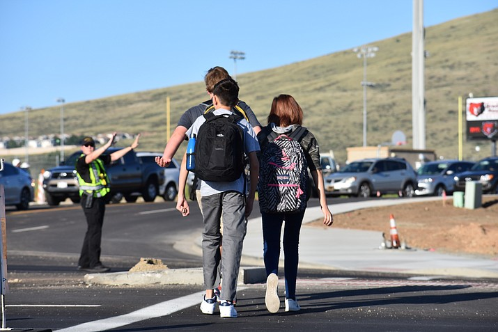 Prescott Valley police officers direct first-day-of-school traffic at the intersection of Glassford Hill Road and Long Look Drive in front of Bradshaw Mountain High School Monday morning, August 7, 2017. The traffic lights are missing from the intersection because the new signals did not arrive in time for the school start day. (Richard Haddad/WNI)