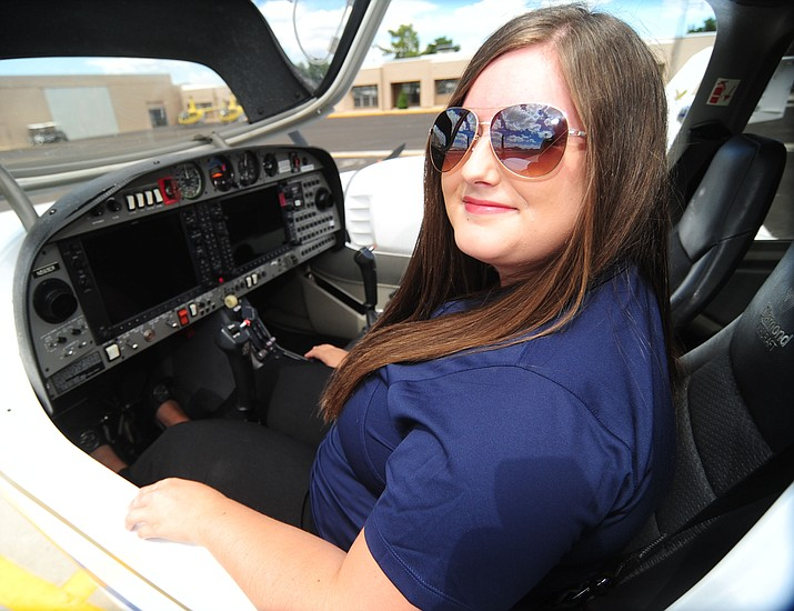 ERAU graduate Kristin Gibson was selected to work for Mokulele Airlines in Hawaii. Gibson worked two jobs as a full time college student to afford her start in aviation. (Les Stukenberg/The Daily Courier).