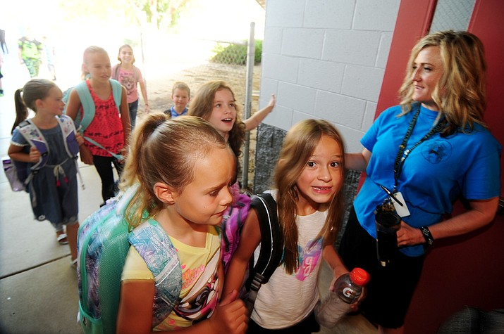 Principal Candice Blakely Stump greets students at Coyote Springs Elementary School in Prescott Valley as Humboldt Unified School District starts their 2017/18 school year Monday, August 7. (Les Stukenberg/Courier)