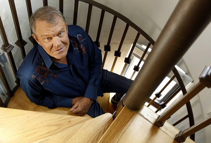 In this July 27, 2011 photo, musician Glen Campbell poses for a portrait in Malibu, Calif. (Matt Sayles, AP File)