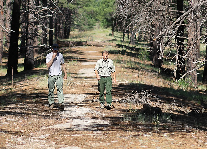 Neil Weintraub and forest intern Griffin Boehm walk part of the course of the 1928 Transcontinental Footrace on old Route 66 near Parks, Arizona.