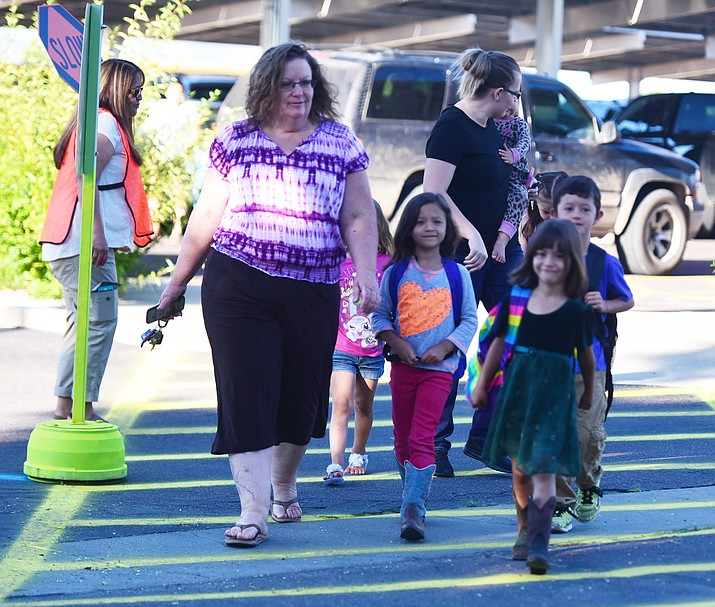 Busy morning in the crosswalk for the first day of school at Territorial Elementary School in Chino Valley Tuesday, August 8. (Les Stukenberg/The Daily Courier).