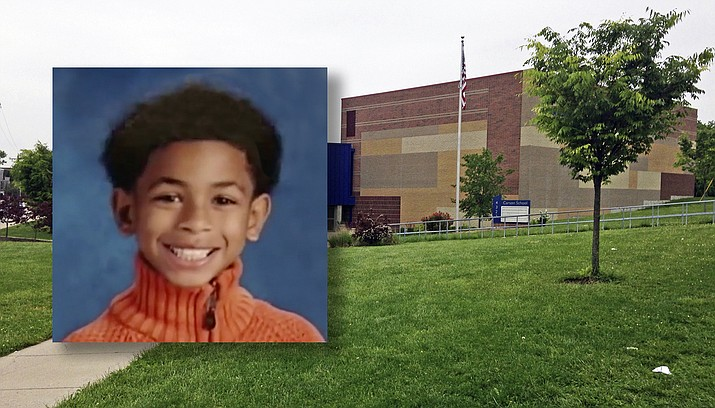 """Eight-year-old Gabriel Taye was a student at Carson School, an elementary school in Cincinnati. A federal lawsuit filed Monday says a """"treacherous school environment"""" that allowed and covered up bullying led to his suicide. (AP Photo/Lisa Cornwell, File)"""