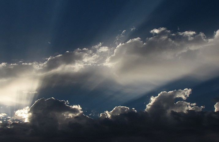 Sunlight and shadows transform clouds into heavenly sights.