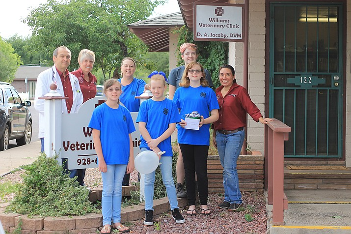 Williams Mountaineers 4-H group donate a sewing project to the Williams Veterinary Clinic July 24. The girls grew catnip and sewed pillows for the animals.  From left: Dr. Daniel Jacoby, Tracy Melchert, Julia Dyer, Holly Harris, Kindle Harris, Emily Jenks, Maddison Jenks and Cindy Aguilar.