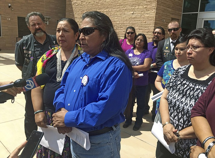 Gary Mike, front, father of 11-year-old Ashlynne Mike, speaks outside of federal court in Albuquerque, N.M., Aug. 1 after the man charged with her murder and sexual assault pleaded guilty. AP Photo/Russell Contreras