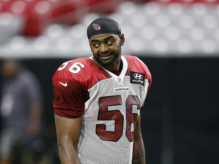 Arizona Cardinals linebacker Karlos Dansby pauses on the sidelines Monday, July 24, 2017, in Glendale. (Ross D. Franklin/AP)