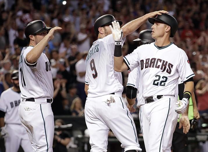 Arizona Diamondbacks' Jake Lamb (22) celebrates after hitting a grand slam against the Los Angeles Dodgers on Tuesday, Aug. 8, 2017, in Phoenix. (Matt York/AP)