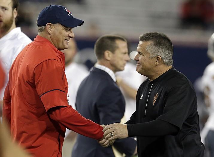 Arizona head coach Rich Rodriguez, left, and Arizona State head coach Todd Graham shake hands before a college football game Friday, Nov. 25, 2016, in Tucson. (Rick Scuteri/AP, File)