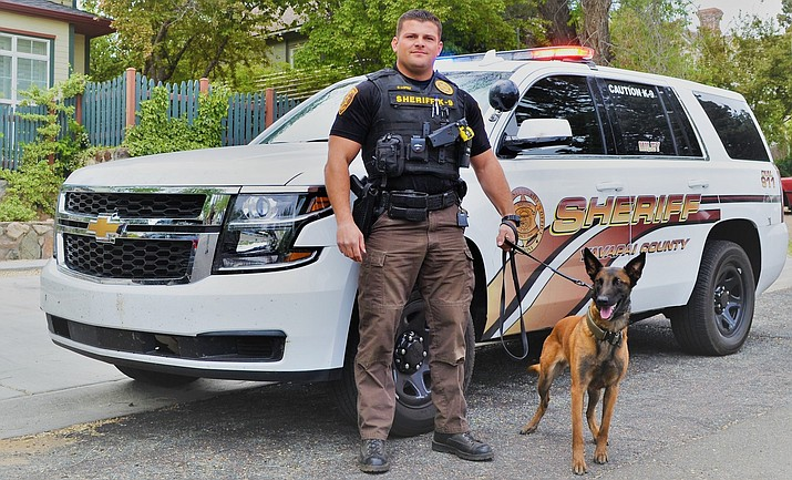 Detective Eric Lopez and K9 Miley. Photo courtesy of YCSO