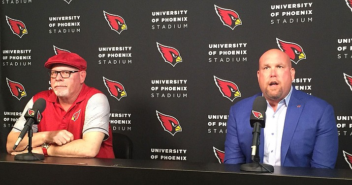 Cardinals coach Bruce Arians, left, and General Manager Steve Keim are pleased with Budda Baker, the youngest player on the roster at 21 years old.