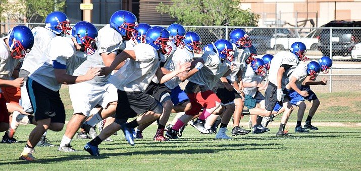 Camp Verde football players run 20 yard sprints during practice on Tuesday. With about 20 less players on the roster than last year's final roster, the Cowboys are working more on conditioning to prepare two-way players. (VVN/James Kelley)