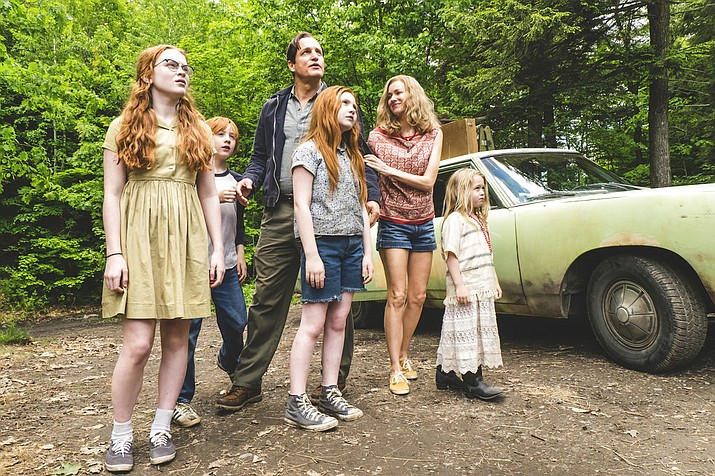 "This image released by Lionsgate shows, from left, Sadie Sink, Charlie Shotwell, Ella Anderson, foreground center, Woody Harrelson, Naomi Watts and Eden Grace Redfield in ""The Glass Castle."" ( Jake Giles Netter/Lionsgate via AP)"